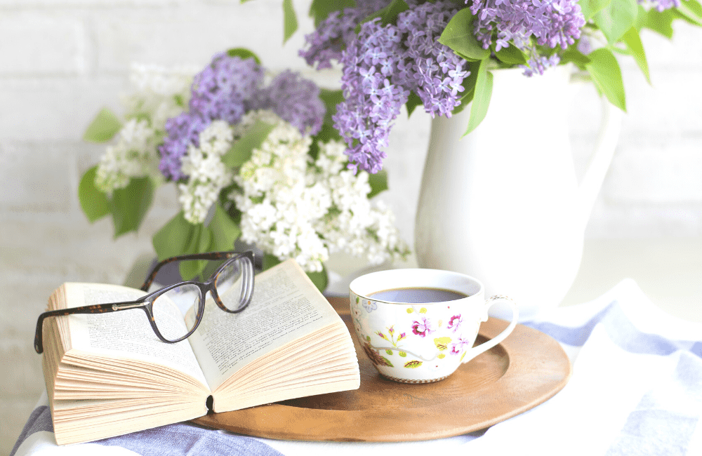 """An image of a book, a cup, a flower vase, etc., used as an image for the article """"It's 2021. Is It Too Late to Start a Blog? (Hint: It's Not, But You Should Find Out Why)"""" on phmillennia.com"""