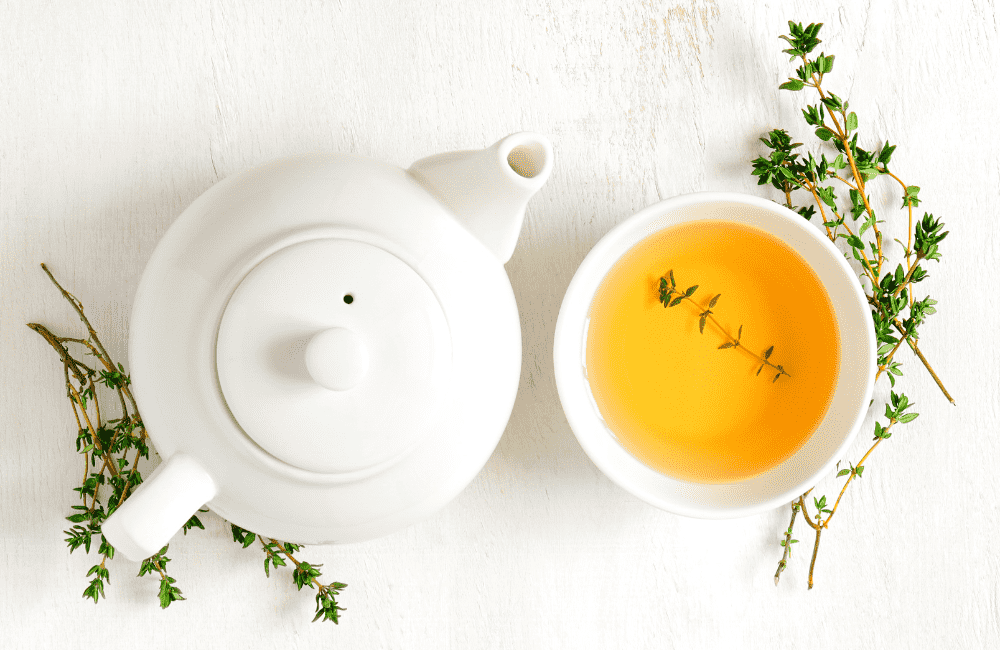 """An image of a teapot and a cup of tea surrounded by leaves on a white surface, used as an image for the article """"It's 2021. Is It Too Late to Start a Blog? (Hint: It's Not, But You Should Find Out Why)"""" on phmillennia.com"""