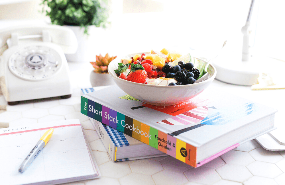 """An image of a bowl of fruits atop a book, amongst other things, used as an image for the article """"It's 2021. Is It Too Late to Start a Blog? (Hint: It's Not, But You Should Find Out Why)"""" on phmillennia.com"""