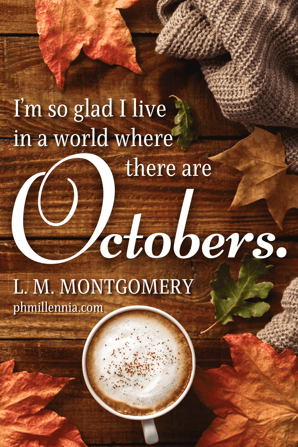 """A graphic featuring an autumn quote/fall saying over an image of a cup of hot cocoa, sweater cloth, fall/autumn leaves, and other fall/autumn-related items arranged on a wooden surface, designed as a Pinterest Pin for the article """"199 Autumn Quotes to Fall Deeply and Spectacularly in Love With"""" on phmillennia.com"""