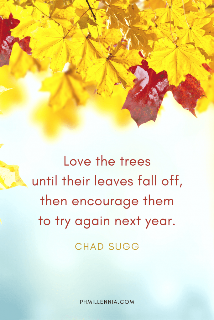 """A graphic featuring an autumn quote/fall saying over an image of leaves and foliage in autumn/fall season, designed as a Pinterest Pin for the article """"199 Autumn Quotes to Fall Deeply and Spectacularly in Love With"""" on phmillennia.com"""
