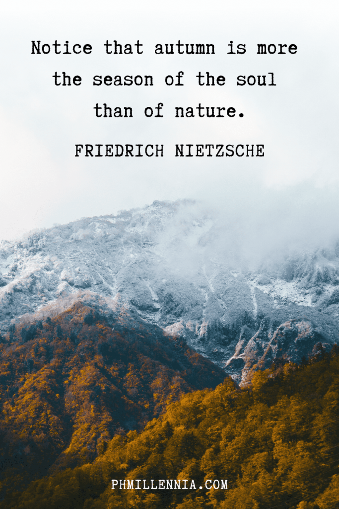 """A graphic featuring an autumn quote/fall saying over an image of an autumn/fall season forest backdropped by misty mountains, designed as a Pinterest Pin for the article """"199 Autumn Quotes to Fall Deeply and Spectacularly in Love With"""" on phmillennia.com"""