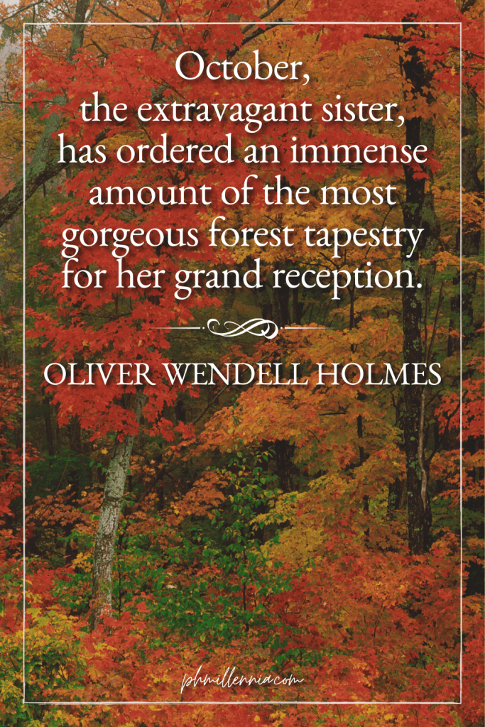 """A graphic featuring an autumn quote/fall saying over an image of a forest with trees and foliage in autumn/fall colors, designed as a Pinterest Pin for the article """"199 Autumn Quotes to Fall Deeply and Spectacularly in Love With"""" on phmillennia.com"""