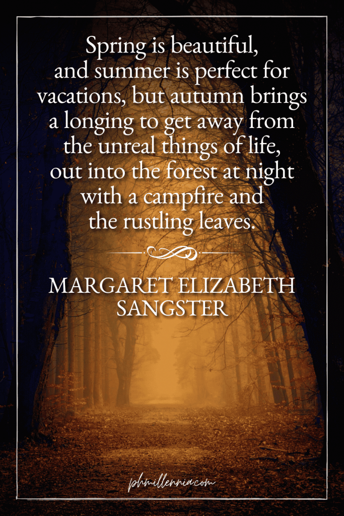 A graphic featuring an autumn quote/fall saying over an image of a dark path covered with leaves and overhung on both sides by dark trees in autumn/fall colors