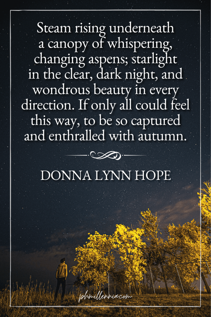 """A graphic featuring an autumn quote/fall saying over an image of a person and trees in autumn/fall colors on a field on a starry night, designed as a Pinterest Pin for the article """"199 Autumn Quotes to Fall Deeply and Spectacularly in Love With"""" on phmillennia.com"""