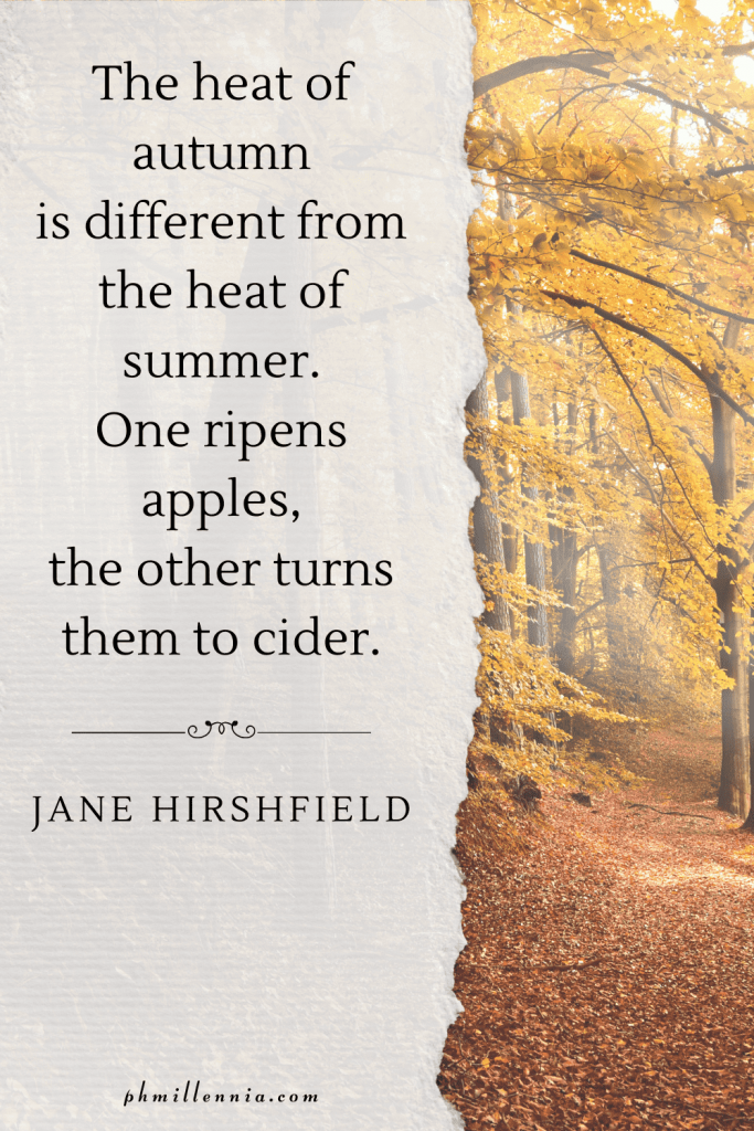"""A graphic featuring an autumn quote/fall saying over an image of a woodland path covered with leaves, through a forest of trees with autumn/fall foliage, designed as a Pinterest Pin for the article """"199 Autumn Quotes to Fall Deeply and Spectacularly in Love With"""" on phmillennia.com"""