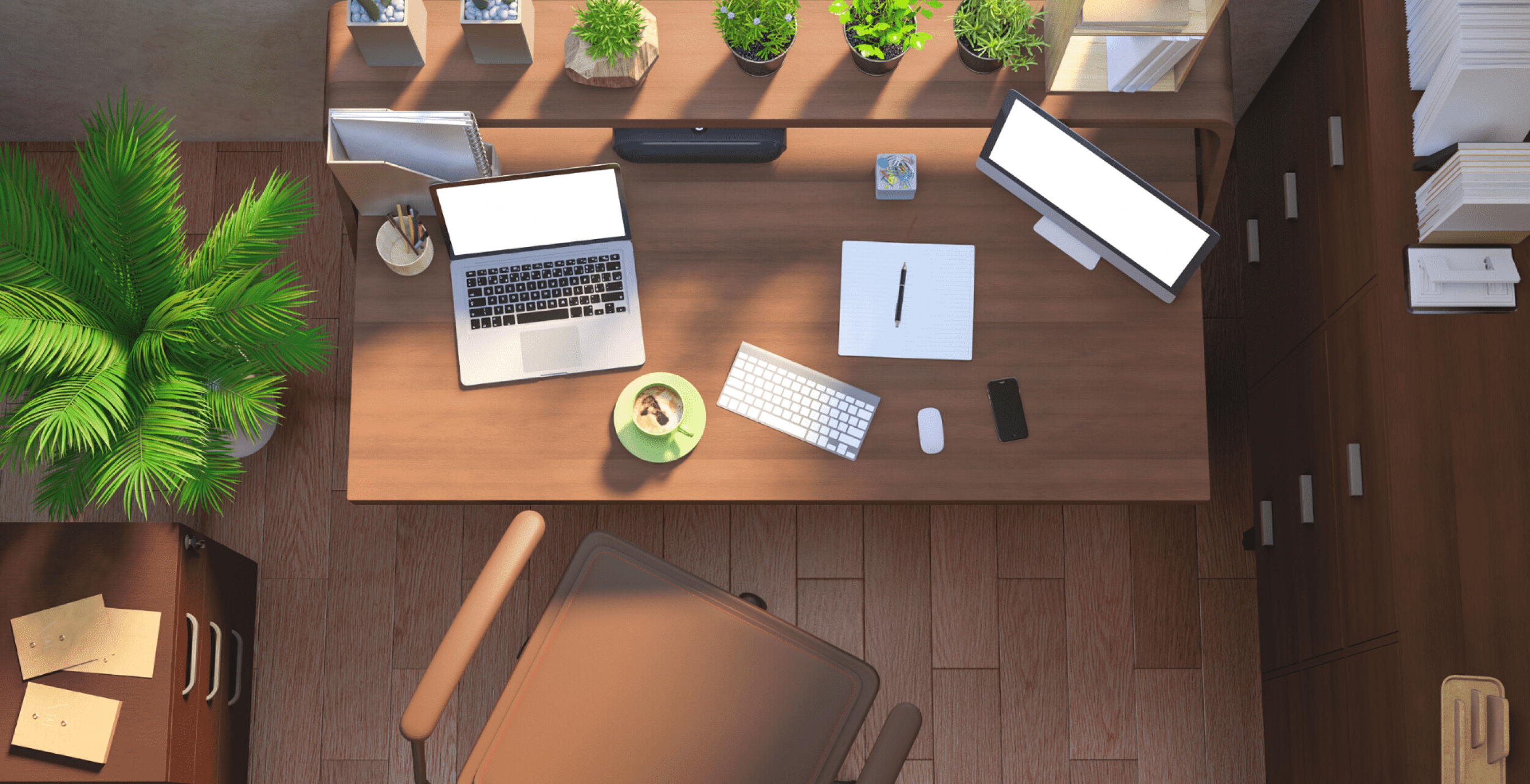 An aerial view of a task chair and desk with work-related equipment, used as the featured image for the article 'Useful Desk Accessories for Your Home Office' on phmillennia.com